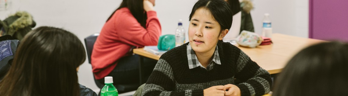 International Students have a discussion in class