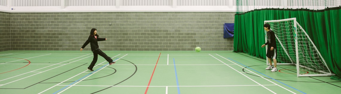 International Students play football in the college sports hall
