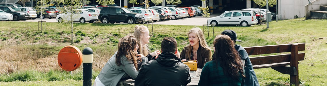 College students chat over lunch outside City campus